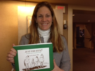 Dr. Lisa Handy with a copy of her book